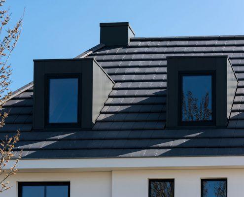 Dakkapellen en schoorstenen voorzien van zetwerk op maat - Woonhuis Sambeek